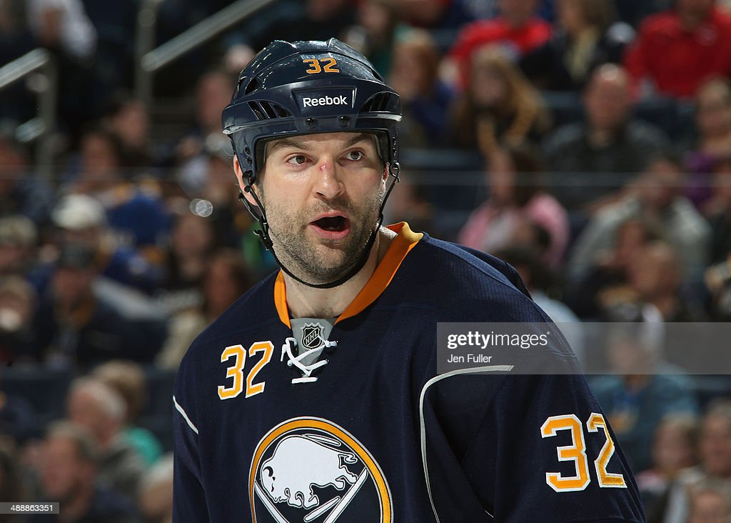 John Scott #32 of the Buffalo Sabres skates against the New York Islanders at First Niagara Center on April 13, 2014 in Buffalo, New York.
