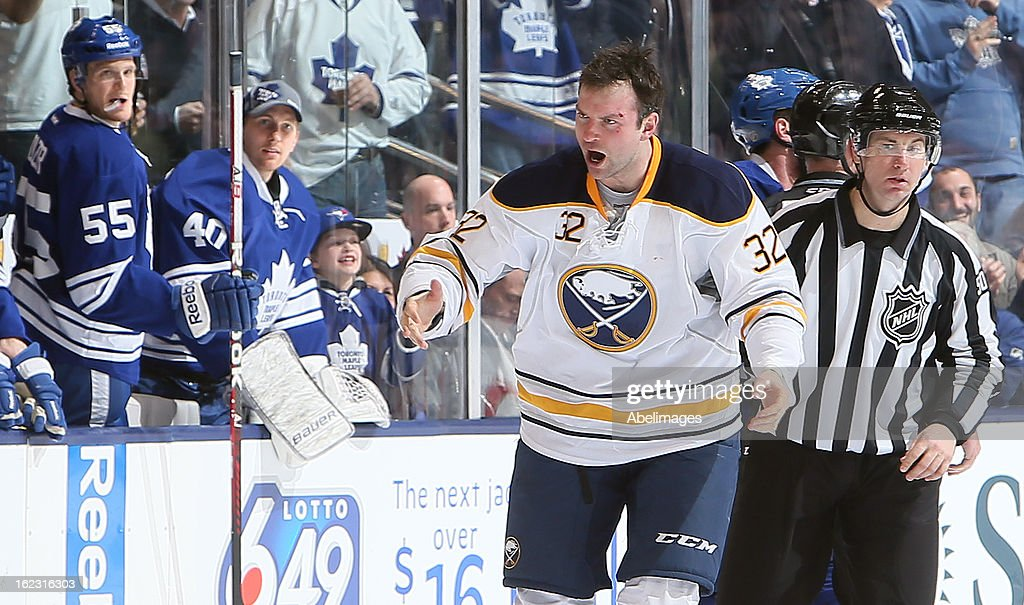 John Scott #32 of the Buffalo Sabres tries to pump up his team during NHL action at the Air Canada Centre February 21, 2013 in Toronto, Ontario, Canada.