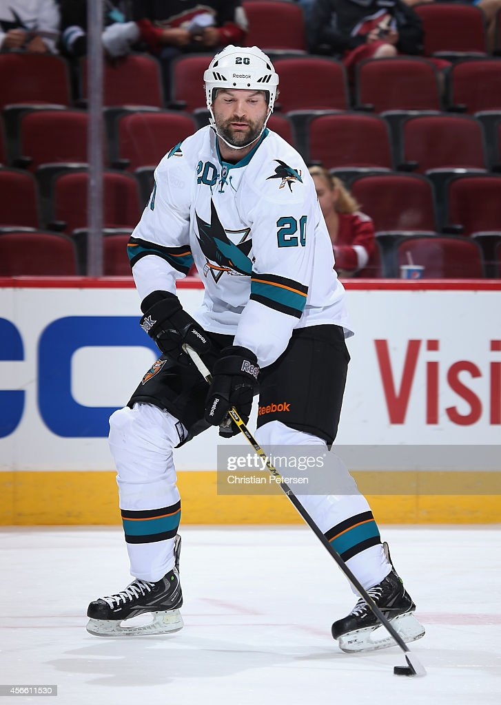 John Scott #20 of the San Jose Sharks warms up before the preseason NHL game against the Arizona Coyotes at Gila River Arena on October 3, 2014 in Glendale, Arizona.