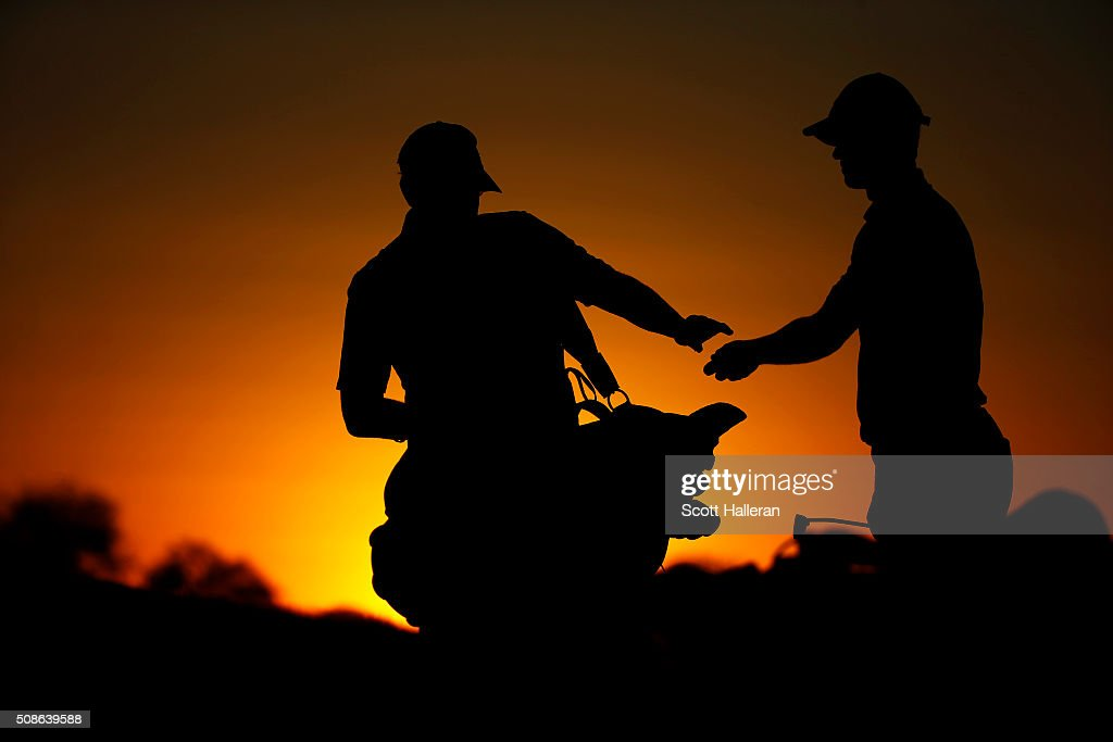 John Senden of Australia gets a ball from his caddie on the ninth hole during the second round of the Waste Management Phoenix Open at TPC Scottsdale on February 5, 2016 in Scottsdale, Arizona.