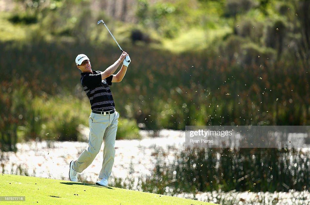 John Senden of Australia hits an iron shot during the Pro-Am ahead of the 2012 Australian Open, beginning tomorrow, at The Lakes Golf Club on December 5, 2012 in Sydney, Australia.