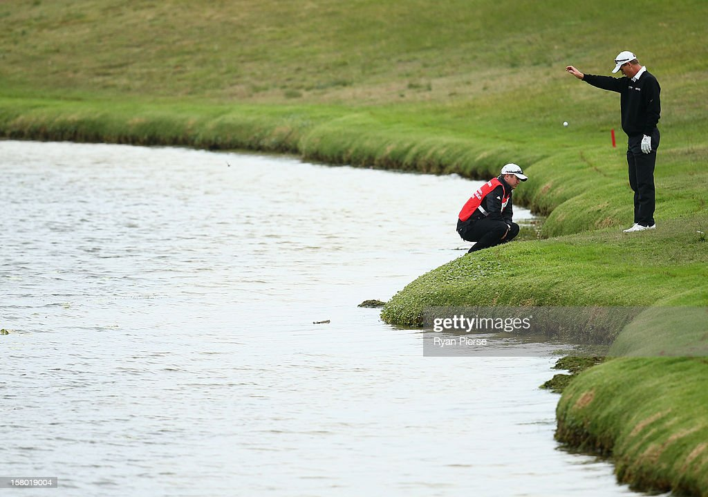 John Senden of Australia makes a drop during round four of the 2012 Australian Open at The Lakes Golf Club on December 9, 2012 in Sydney, Australia.