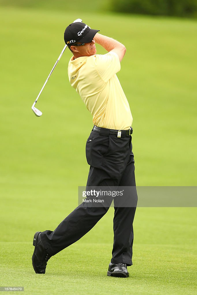 <a gi-track='captionPersonalityLinkClicked' href=/galleries/search?phrase=John+Senden&family=editorial&specificpeople=588020 ng-click='$event.stopPropagation()'>John Senden</a> of Australia plays a fairway shot during round two of the 2012 Australian Open at The Lakes Golf Club on December 7, 2012 in Sydney, Australia.