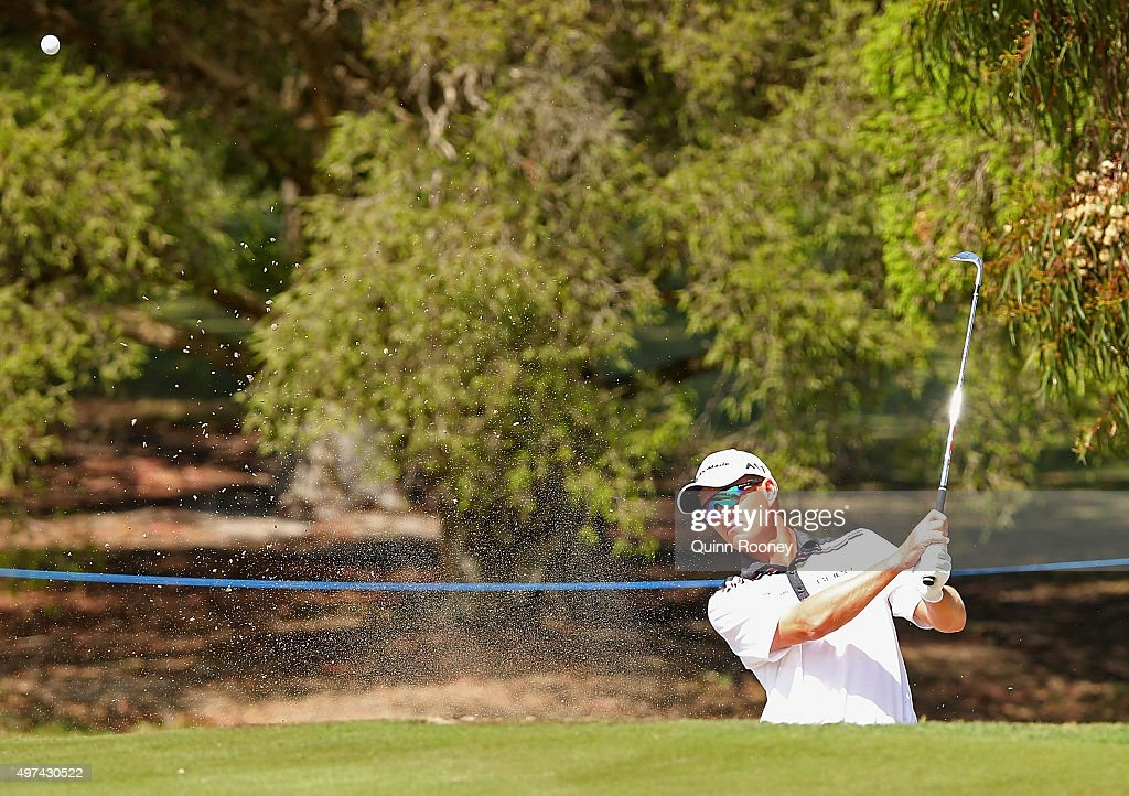 <a gi-track='captionPersonalityLinkClicked' href=/galleries/search?phrase=John+Senden&family=editorial&specificpeople=588020 ng-click='$event.stopPropagation()'>John Senden</a> of Australia plays out of the bunker during a practice round ahead of the 2015 Australian Masters at Huntingdale Golf Course on November 17, 2015 in Melbourne, Australia.