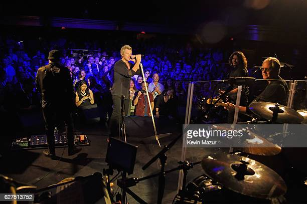 John Shanks Jon Bon Jovi Phil X and Tico Torres onstage during Bon Jovi Live presented by SiriusXM during Art Basel at the Faena Theater on December...