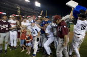 John Shimkus dumps the cooler on Joe Barton after the Republicans won the Roll Call Congressional Baseball Game at National Stadium on Thursday July...