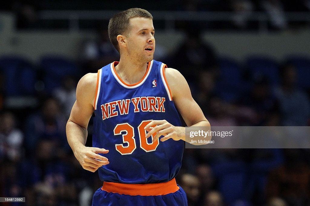 John Shurna #30 of the New York Knicks in action against the Brooklyn Nets during a preseason game at Nassau Coliseum on October 24 2012 in Uniondale, New York The Knicks defeated the Nets 97-95.