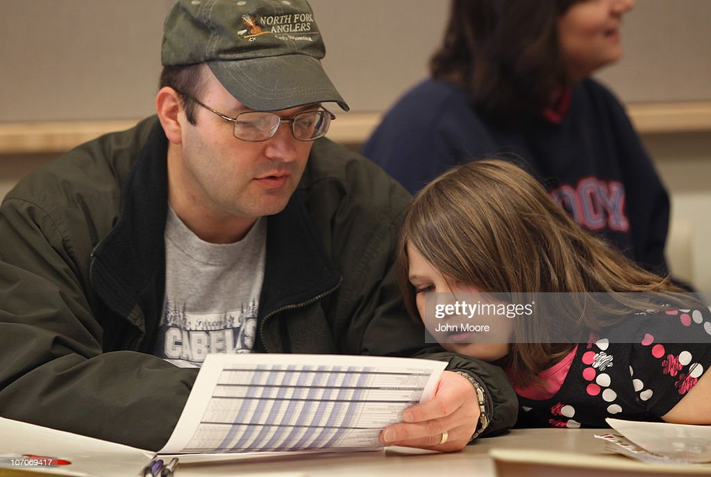 John Simms III and his daughter Mandy look over a nutritional guide during the Shapedown program for overweight adolescents and children on November 13, 2010 in Aurora, Colorado. The 10-week family-centered program held by the Denver area Children's Hospital aims to teach youth and their parents ways to lead a healthier more active lifestyle, as a longer lasting weight-loss alternative to dieting. Nationally, some 15 percent of children are overweight or obese, as are some 60 percent of adults.