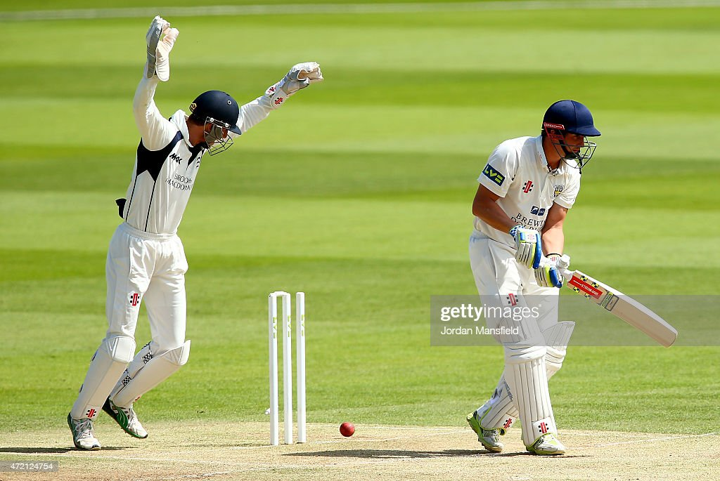 John Simpson of Middlesex celebrates as the ball hits the stumps as Phil Mustard of Durham is bowled out during day three of the LV County...