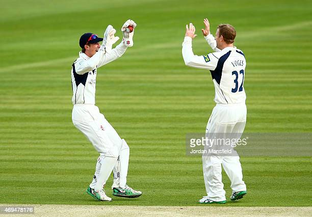 John Simpson of Middlesex celebrates with Adam Voges of Middlesex after they get the wicket of Vernon Philander of Nottinghamshire during day one of...