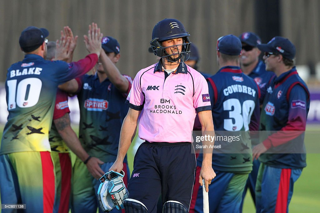 <a gi-track='captionPersonalityLinkClicked' href=/galleries/search?phrase=John+Simpson+-+Cricket+Player&family=editorial&specificpeople=12951507 ng-click='$event.stopPropagation()'>John Simpson</a> of Middlesex walks from the field after losing his wicket as Kent players celebrate during the Natwest T20 Blast match between Kent and Middlesex at The Spitfire Ground on June 24, 2016 in Canterbury, England.