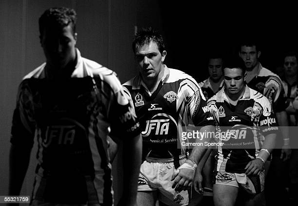 John Skandalis of the Tigers and team mates walk out the tunnel during the Qualifying Final between the Wests Tigers and the North Queensland Cowboys...