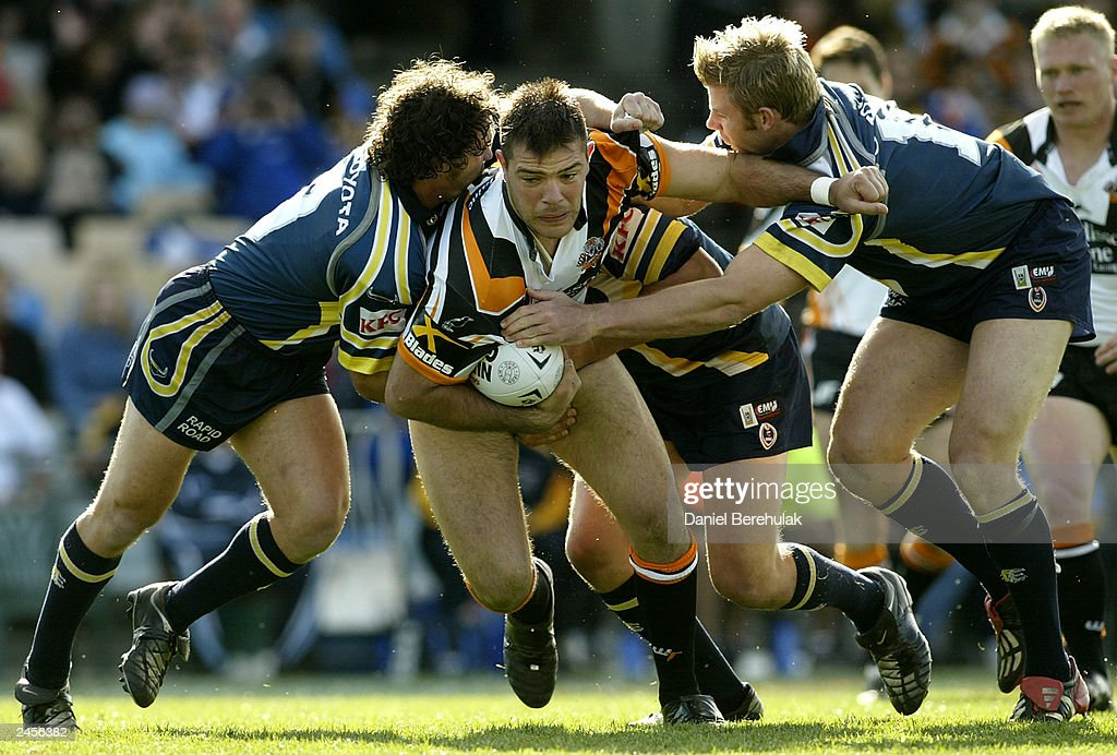 John Skandalis #10 of the Tigers in action during the round 25 NRL match between the Wests Tigers and the North Queensland Cowboys at Campbelltown Oval August 31, 2003 in Sydney, Australia.