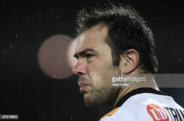 John Skandalis of the Tigers waits on the sideline to take the filed during the round 11 NRL match between the Wests Tigers and the Brisbane Broncos...