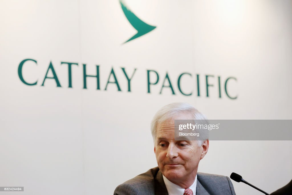 John Slosar, chairman of Cathay Pacific Airways Ltd., attends a news conference in Hong Kong, China, on Wednesday, Aug. 16, 2017. Cathay Pacific is slipping in its efforts to get passengers to pay more for its premium services in a test for new Chief Executive Officer Rupert Hogg as the company reported back-to-back losses. Photographer: Paul Yeung/Bloomberg via Getty Images