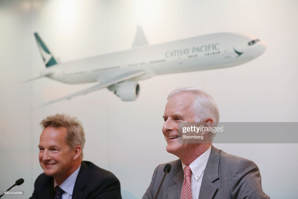 John Slosar, chairman of Cathay Pacific Airways Ltd., right, and Rupert Hogg, chief executive officer, react during a news conference in Hong Kong, China, on Wednesday, Aug. 16, 2017. Cathay Pacific is slipping in its efforts to get passengers to pay more for its premium services in a test for new Chief Executive Officer Hogg as the company reported back-to-back losses. Photographer: Paul Yeung/Bloomberg via Getty Images