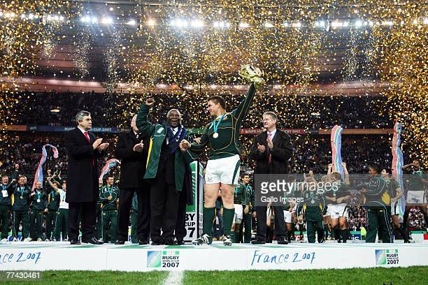 John Smit of South Africa holds the trophy with South African President Thabo Mbeki at the end IRB 2007 Rugby World Cup final match between South...