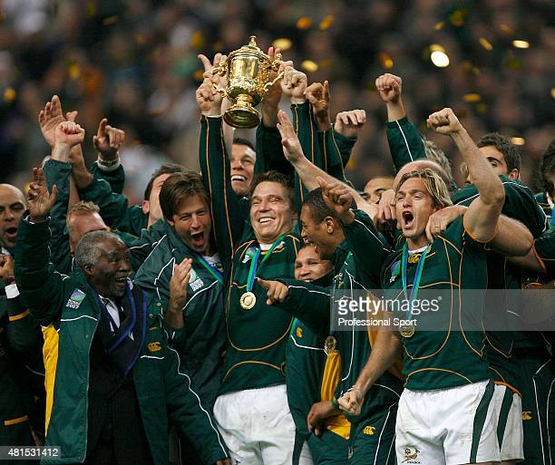 John Smit of South Africa lifts the trophy as his team mates celebrate following his team's victory at the end of the 2007 Rugby World Cup Final...