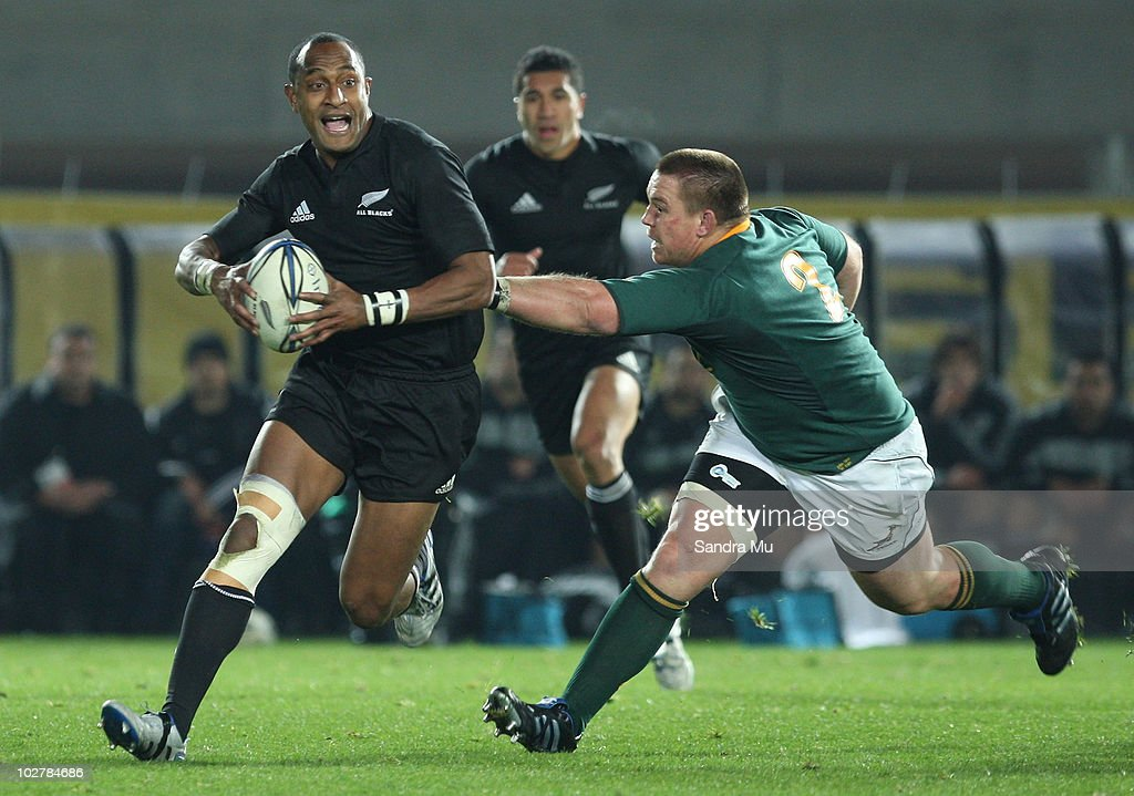 John Smit of the Springboks reaches out to tackle Joe Rokocoko of the All Blacks during the TriNations match between the New Zealand All Blacks and...