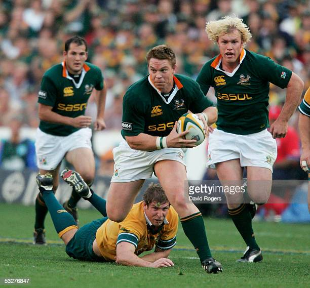 John Smit the Springbok captain avoids a challenge from Daniel Vickerman as he powers forward during the Nelson Mandela Challenge Plate international...