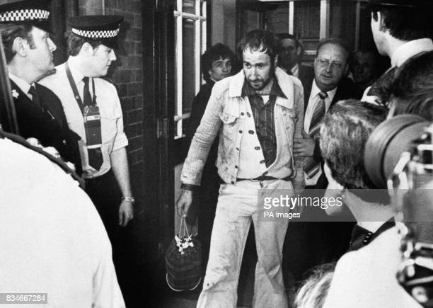 John Smith being arrested after a protest at the top of the Blackpool Tower againt the penal system He was later found guilty for the murder of...