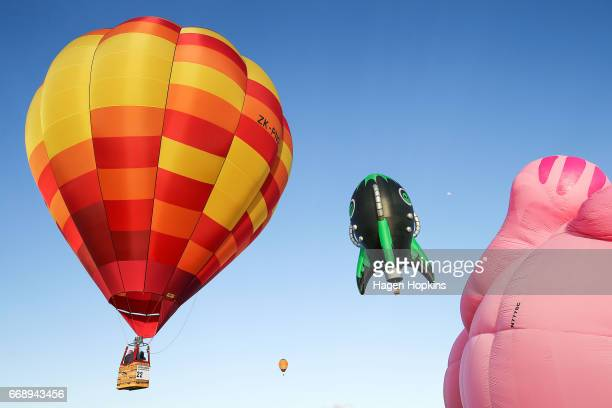 John Snodgrass in 'Wildfire' and Alain Bard in 'Alien Rocket' fly during the Meander over Martinborough event at the Wairarapa Balloon Festival on...