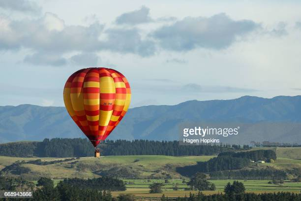 John Snodgrass in 'Wildfire' flies during the Meander over Martinborough event at the Wairarapa Balloon Festival on April 16 2017 in Martinborough...