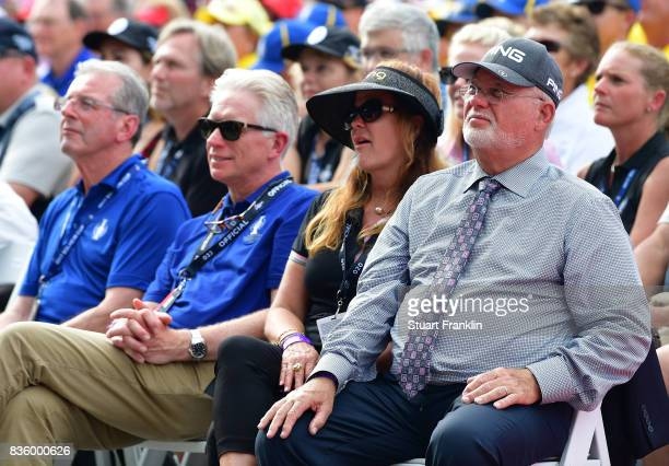 John Solheim CEO of Ping looks on with his wife during the closing ceremony after the final day singles matches of The Solheim Cup at Des Moines Golf...