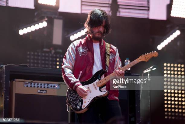 John Squire of the British iconic rock band The Stone Roses perform on stage at Wembley Stadium London on June 17 2017 The band consists in Ian Brown...