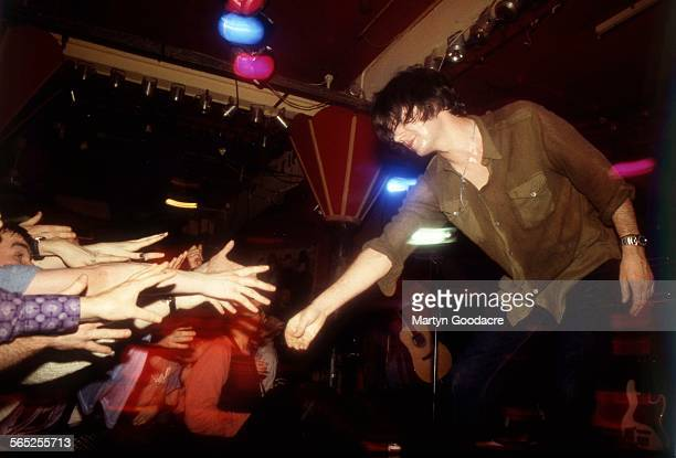 John Squire of The Seahorses reaches out to touch the audience after performing Ireland 1997