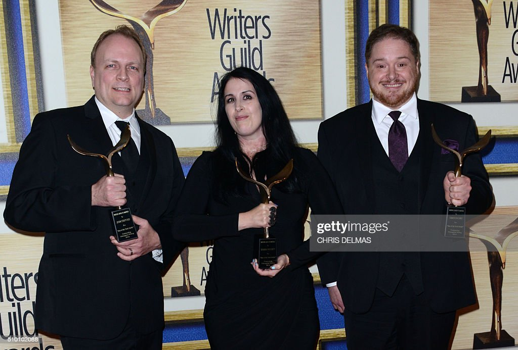 John Stafford, Rhianna Pratchett and Cameron Suey pose in the press room at the Writers Guild Awards, in Century City, California, February 13, 2016. / AFP / CHRIS DELMAS