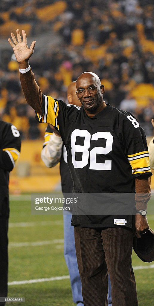 <a gi-track='captionPersonalityLinkClicked' href=/galleries/search?phrase=John+Stallworth&family=editorial&specificpeople=585421 ng-click='$event.stopPropagation()'>John Stallworth</a>, former wide receiver for the Pittsburgh Steelers, acknowledges cheers from the fans during halftime of a game between the Baltimore Ravens and Steelers at Heinz Field on November 18, 2012 in Pittsburgh, Pennsylvania. The Ravens defeated the Steelers 13-10.