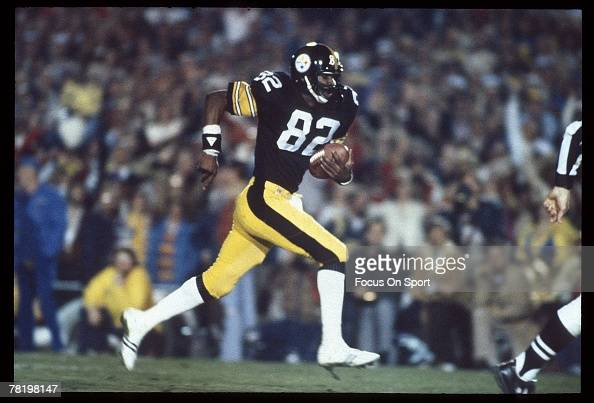 John Stallworth of the Pittsburgh Steelers breaks free and heads for the goal line during Super Bowl XIV against the Los Angeles Rams on January 20...