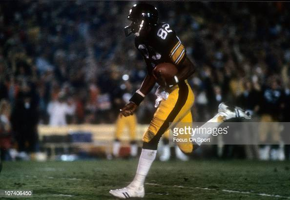 John Stallworth of the Pittsburgh Steelers catches this pass and heads for the goal line during Super Bowl XIV against the Los Angeles Rams at the...