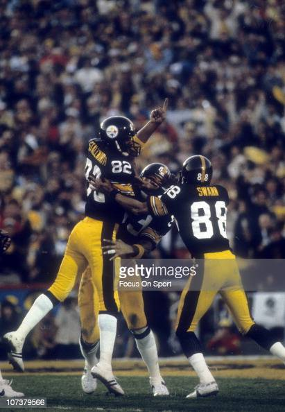 John Stallworth of the Pittsburgh Steelers celebrates with teammates Theo Bell and Lynn Swann after he scores a touchdown during Super Bowl XIV...