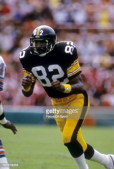 John Stallworth of the Pittsburgh Steelers runs a pass rout against the Miami Dolphins during an NFL football game at The Orange Bowl circa 1985 in...