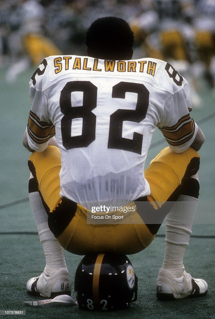 <a gi-track='captionPersonalityLinkClicked' href=/galleries/search?phrase=John+Stallworth&family=editorial&specificpeople=585421 ng-click='$event.stopPropagation()'>John Stallworth</a> #82 of the Pittsburgh Steelers sitting on his helmet, watching the action from the sidelines against the Philadelphia Eagles during an NFL football game at Veterans Stadium September 30, 1979 in Philadelphia, Pennsylvania. Stallworth played for the Steelers from 1974-87.