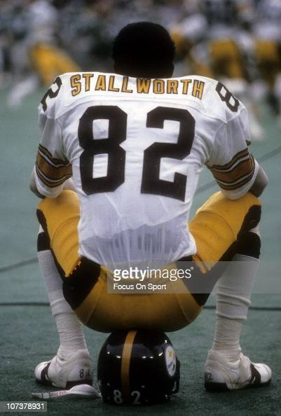 John Stallworth of the Pittsburgh Steelers sitting on his helmet watching the action from the sidelines against the Philadelphia Eagles during an NFL...