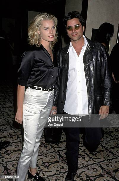 John Stamos and Rebecca Romijn during 4th Annual Race to Erase MS Gala at UCLA Drake Stadium/Century Plaza Hotel in Westwood California United States