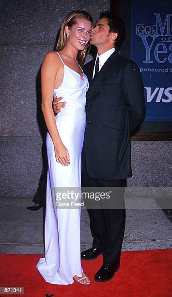 John Stamos and Rebecca Romijn