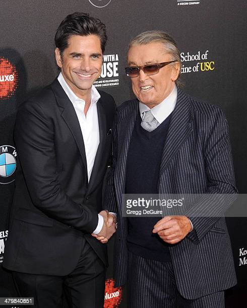 John Stamos and Robert Evans arrive at the 2nd Annual Rebel With A Cause Gala at Paramount Studios on March 20 2014 in Hollywood California