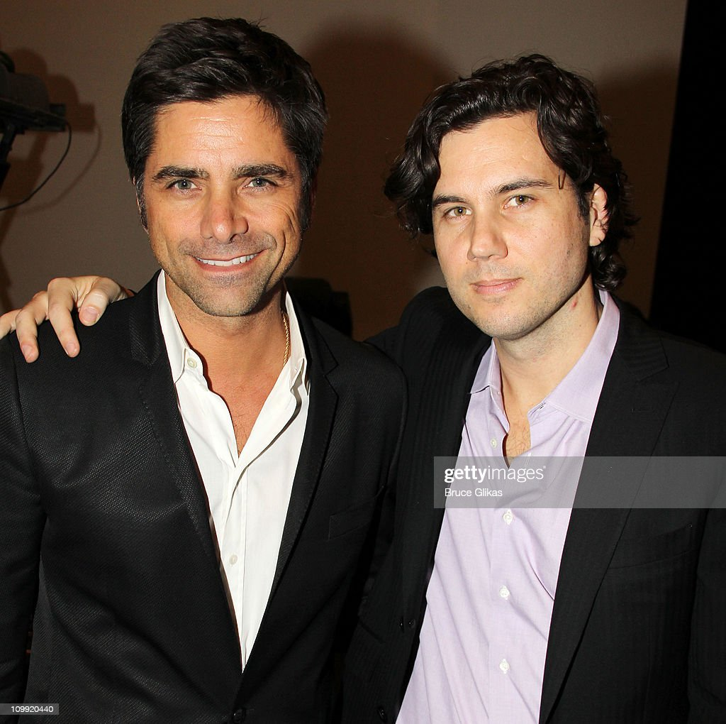 John Stamos and Scott Sartiano pose backstage at 'RainA Tribute To The Beatles' on Broadway at The Brooks Atkinson Theatre on March 9 2011 in New...