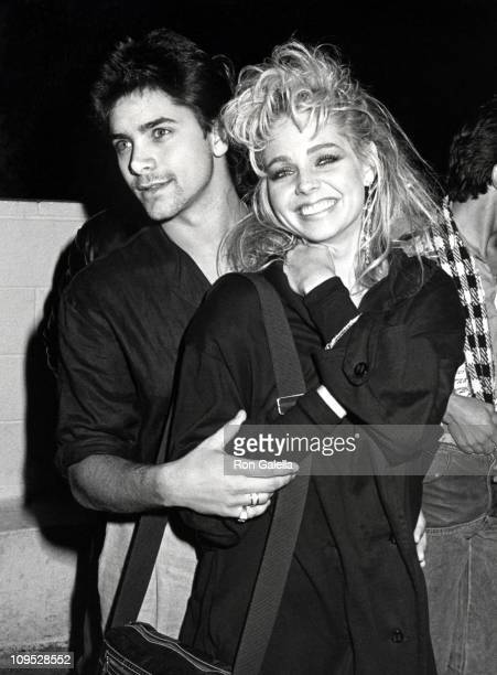 John Stamos and Teri Copley during Party For Hall Oates December 17 1984 at Spago's Restaurant in Hollywood California United States