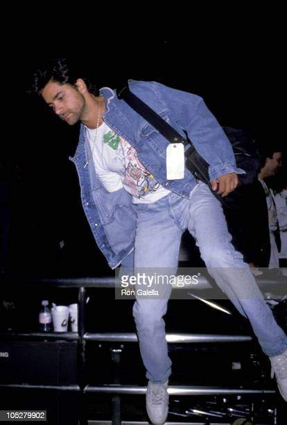 John Stamos during John Stamos Departing for Washington DC at Los Angeles International Airport in Los Angeles California United States