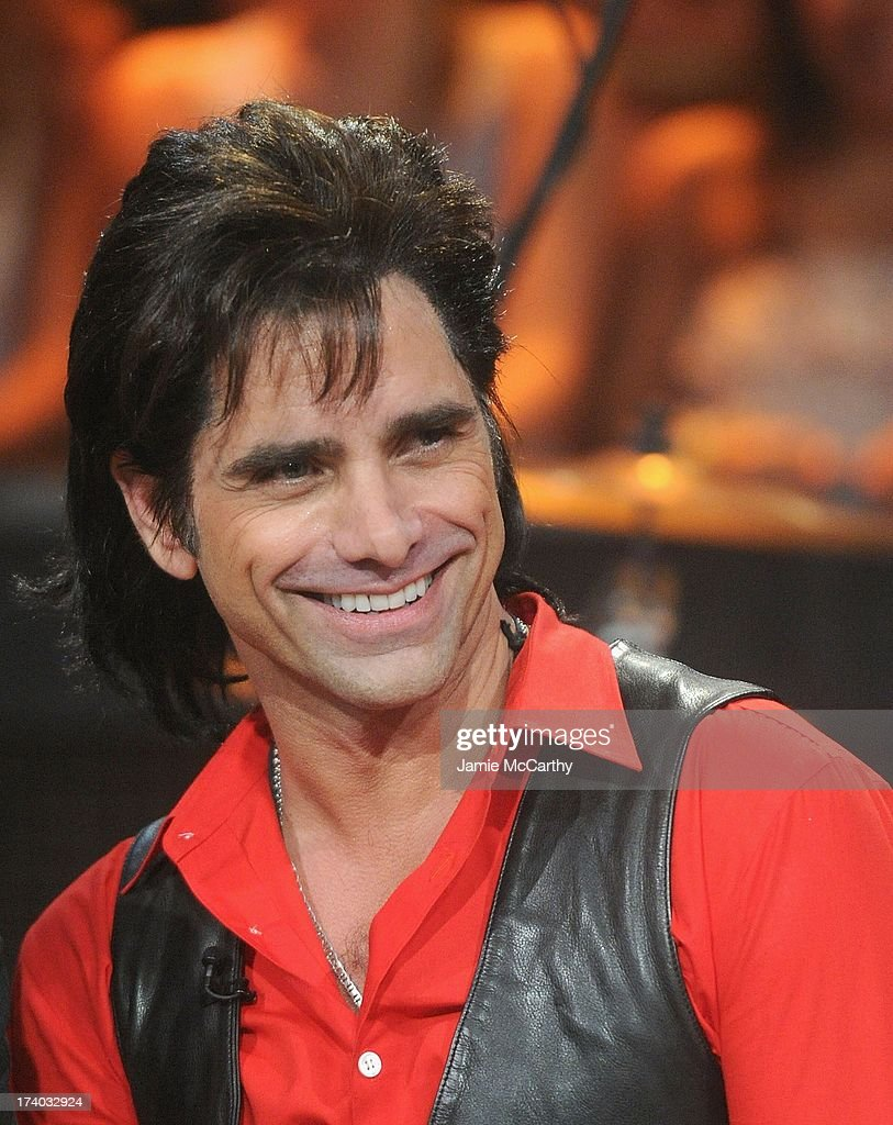 <a gi-track='captionPersonalityLinkClicked' href=/galleries/search?phrase=John+Stamos&family=editorial&specificpeople=206285 ng-click='$event.stopPropagation()'>John Stamos</a> of Jesse and the Rippers visits 'Late Night With Jimmy Fallon' at Rockefeller Center on July 19, 2013 in New York City.