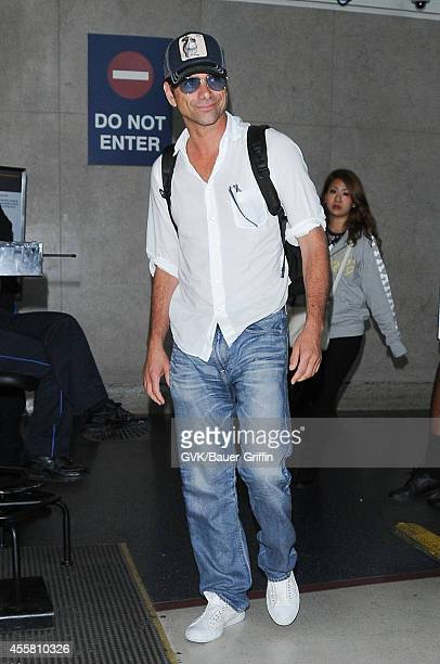 John Stamos seen at LAX on September 20 2014 in Los Angeles California