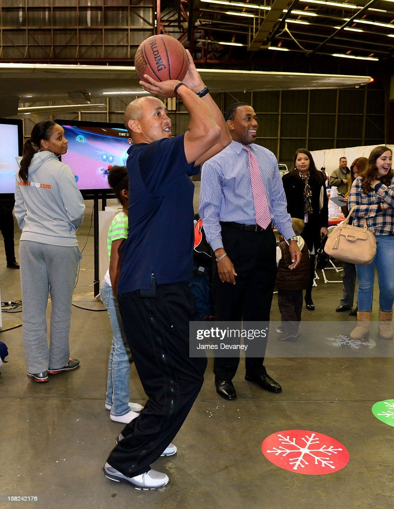 <a gi-track='captionPersonalityLinkClicked' href=/galleries/search?phrase=John+Starks&family=editorial&specificpeople=211118 ng-click='$event.stopPropagation()'>John Starks</a> and Henry Kuykendall attend the 3rd Annual Garden of Dreams Foundation & Delta Air Lines' 'Holiday in the Hangar' event at John F. Kennedy International Airport on December 11, 2012 in New York City.