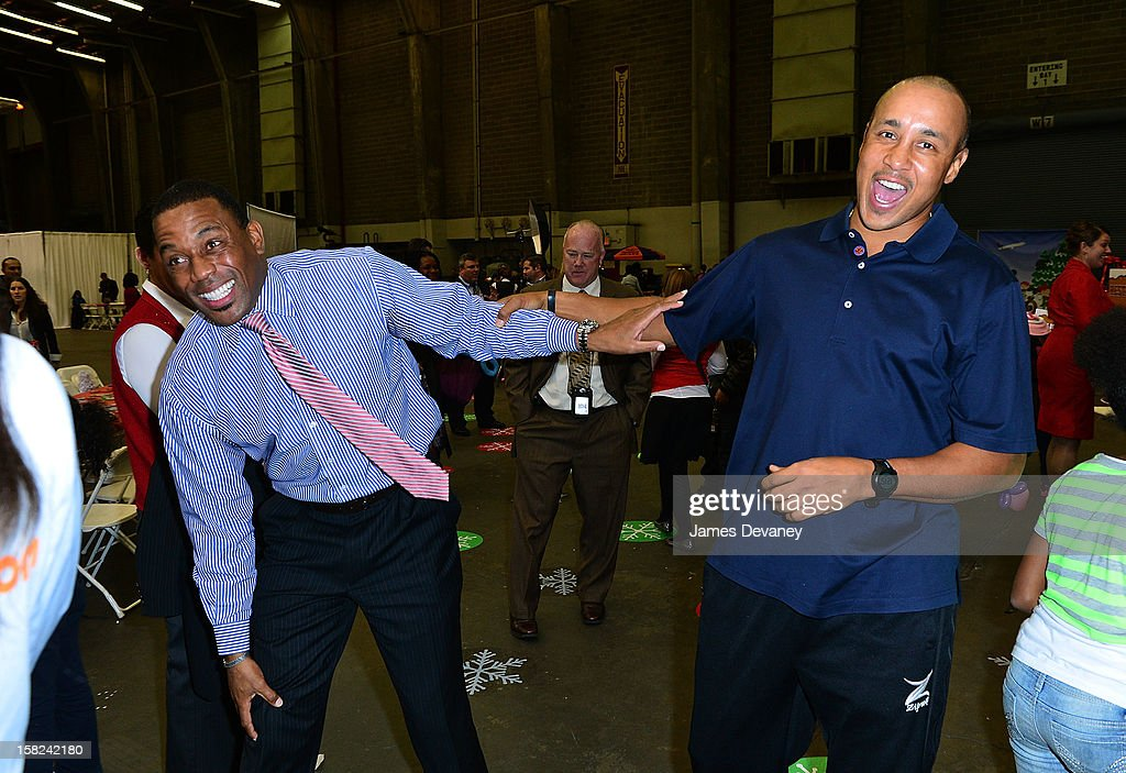 <a gi-track='captionPersonalityLinkClicked' href=/galleries/search?phrase=John+Starks&family=editorial&specificpeople=211118 ng-click='$event.stopPropagation()'>John Starks</a> (R) and Henry Kuykendall attend the 3rd Annual Garden of Dreams Foundation & Delta Air Lines' 'Holiday in the Hangar' event at John F. Kennedy International Airport on December 11, 2012 in New York City.