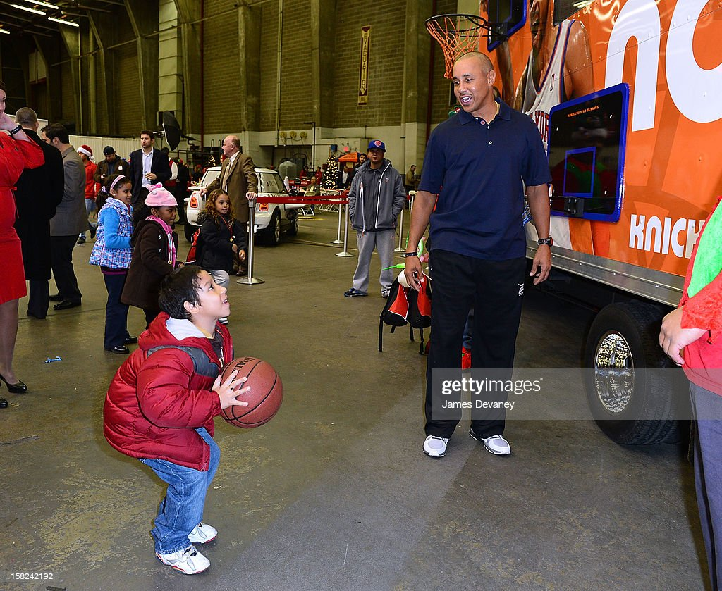 <a gi-track='captionPersonalityLinkClicked' href=/galleries/search?phrase=John+Starks&family=editorial&specificpeople=211118 ng-click='$event.stopPropagation()'>John Starks</a> (R) attends the 3rd Annual Garden of Dreams Foundation & Delta Air Lines' 'Holiday in the Hangar' event at John F. Kennedy International Airport on December 11, 2012 in New York City.