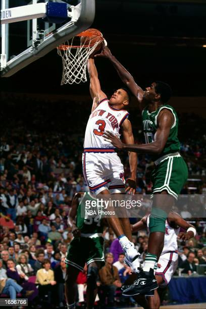 John Starks of the New York Knicks goes for a dunk during the 1990 NBA game against the Boston Celtics at Madison Square Garden in New York New York...